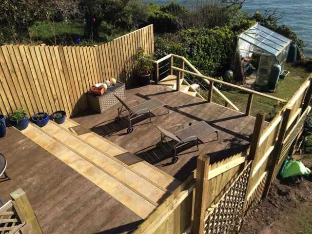 Seating area and steps down to sunbathing area