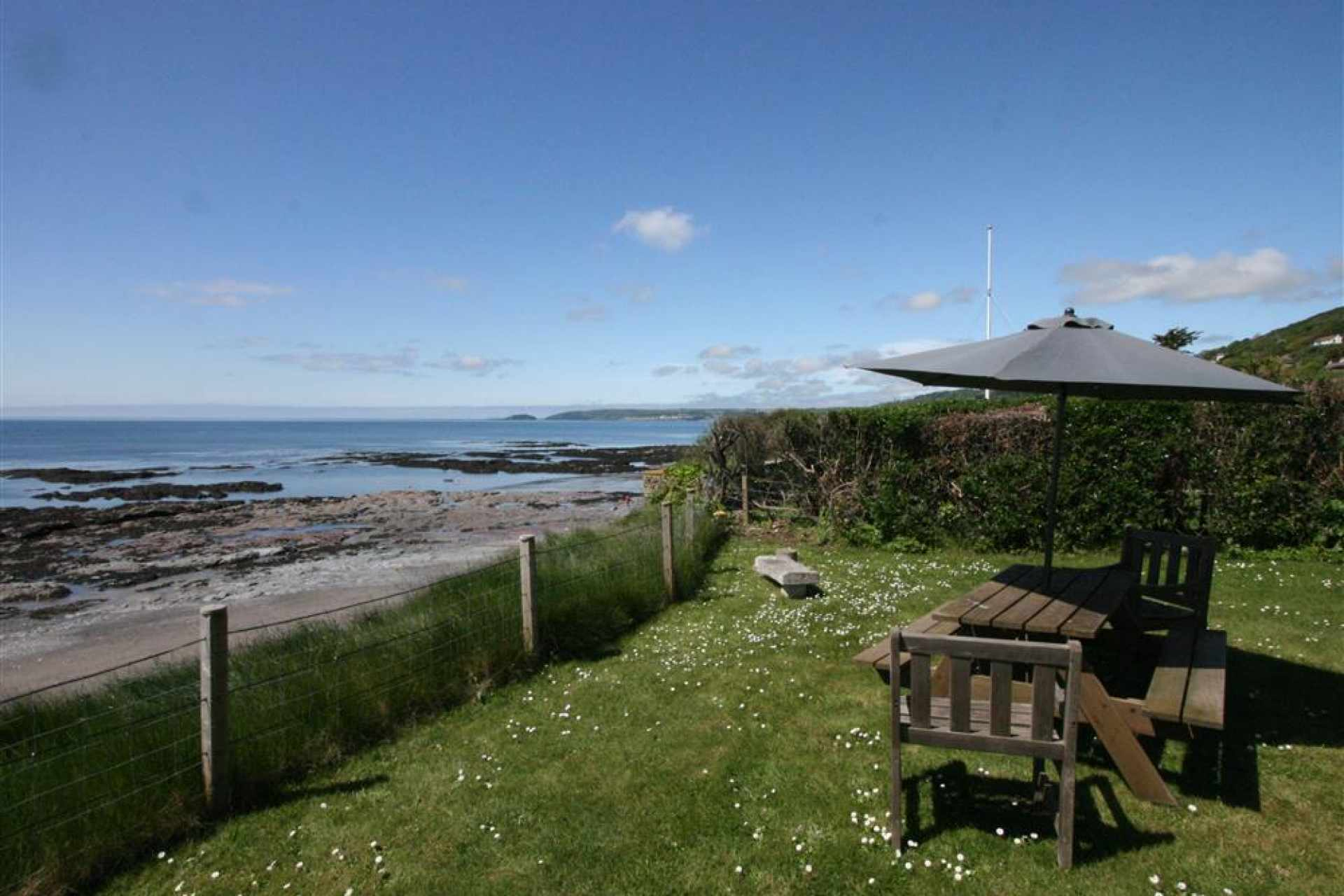 Old Coastguard garden overlooking beach