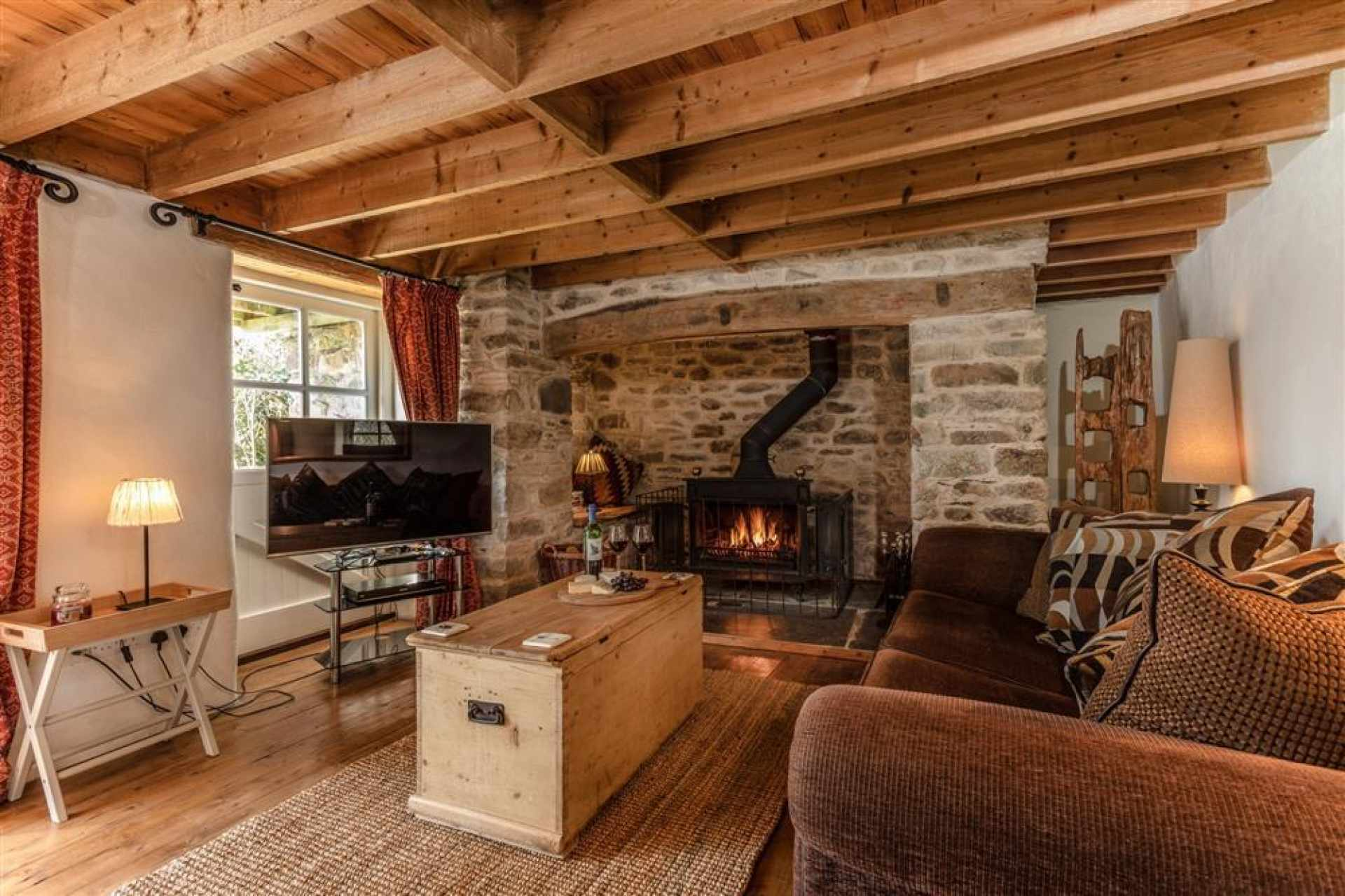 Forge lounge with Inglenook fireplace