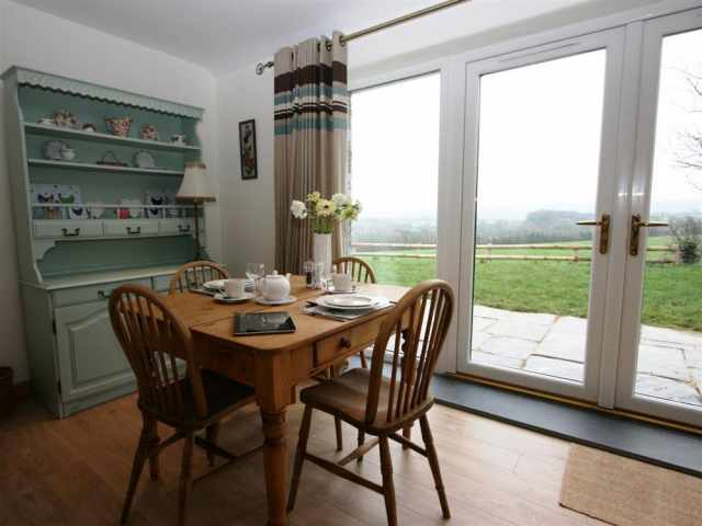 Antique dining table infront of picture window