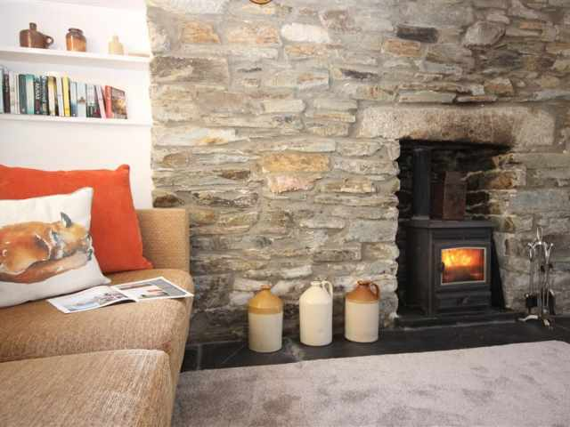 Sofa infront of cosy woodburner