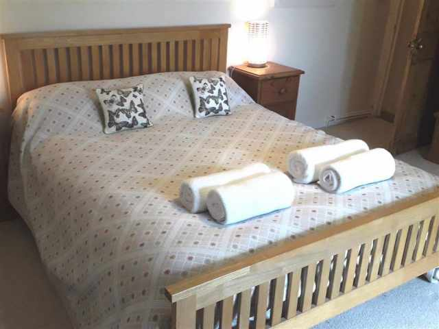 King size bed in spacious bedroom