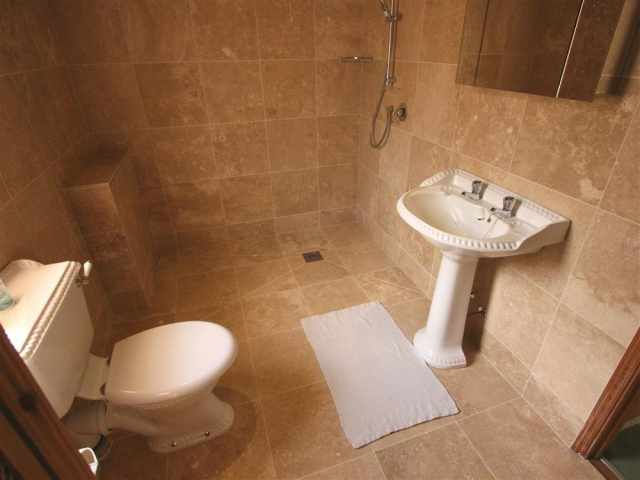 Smart fully tiled wet room