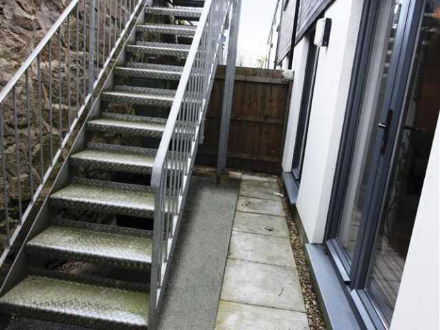 Steps leading to elevated rear garden