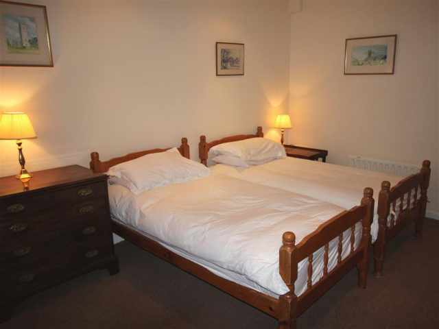 Ground floor twin bedroom with en suite