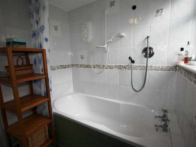 Family bathroom W.C with bath and shower over